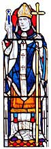 Photograph of a stained glass window depicting St Dunstan