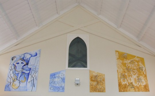 photograph of the church hall showing the four paintings