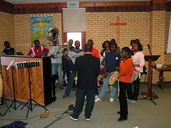 The band playing in the worship area